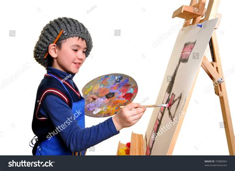 painting boy artist school boy painting brush watercolors stock photo