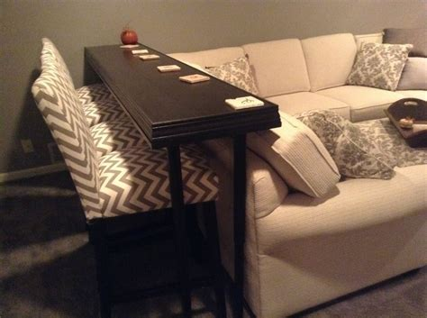 behind sofa good bar table behind couch modern wall sconces and bed