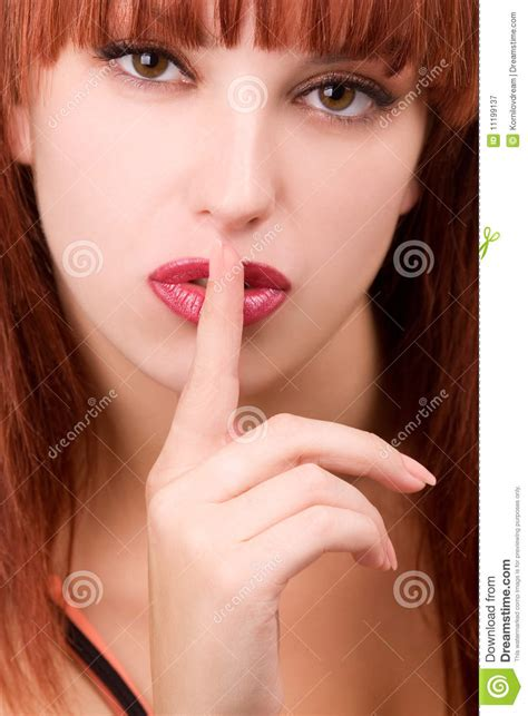 perfect redhead perfect redhead girl making a silence sign royalty free