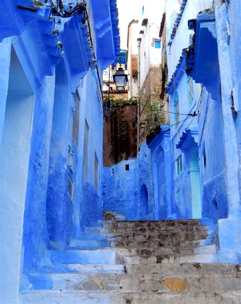 blue city morocco chair inside the medina chefchaouen morocco driftwoodproductions