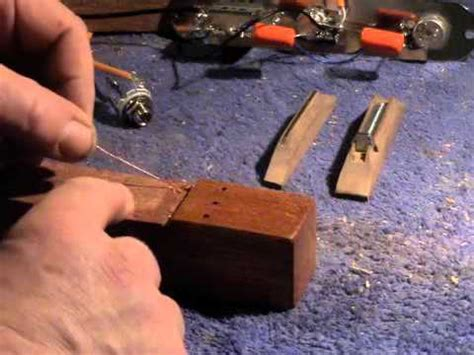 how to earth ground the strings on a cigar box guitar