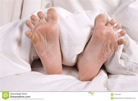 bed feet childs feet in bed royalty free stock photography image