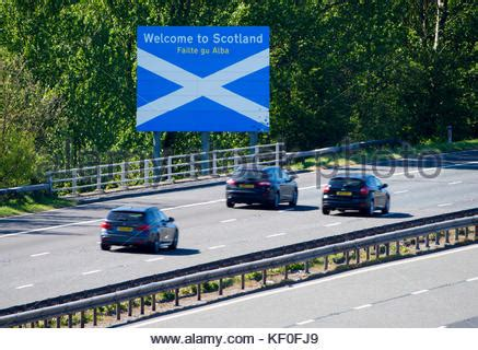 motorway cars welcome to england border sign, cumbria the