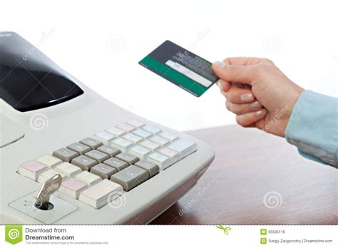 Checkout Register Cashier cashier holding credit card at the checkout