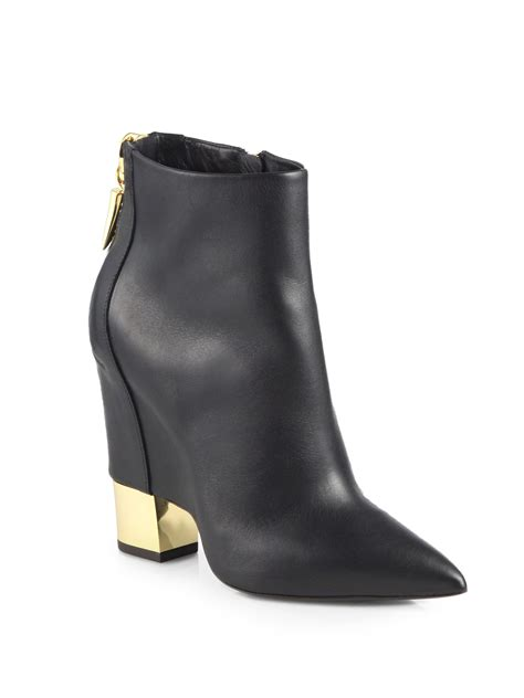 giuseppe boots giuseppe zanotti leather cutout wedge ankle boots in black