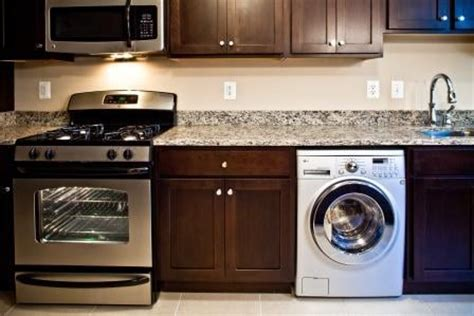 washer dryer in kitchen the shelburne kitchen featuring new appliances including