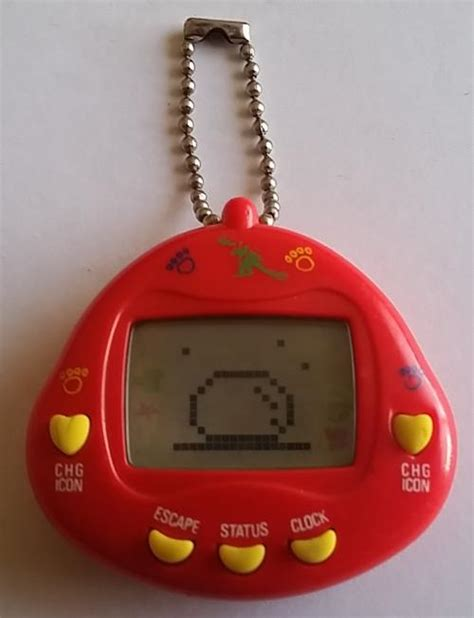 Tamagotchi Tamagochi Dino other toys vey 90 s tamagotchi dinkie dino was sold for r220 00 on 9 aug at 23 02 by