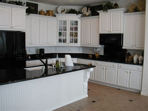 White Or Black Kitchen Cabinets white kitchen cabinets with black appliances home
