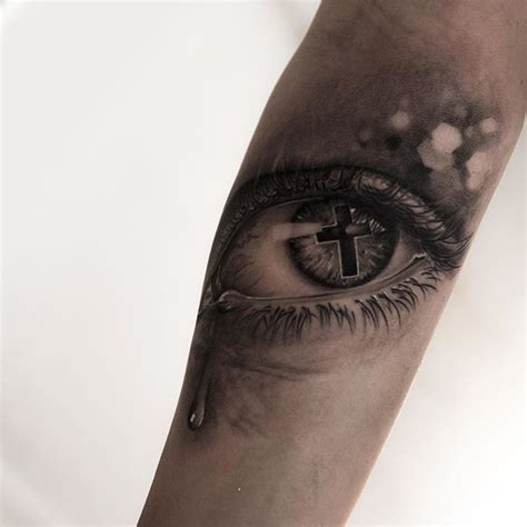 cross tattoo under eye 78 ideas about eye tattoos on real
