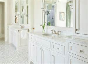 white bath vanity with oval glass knobs transitional