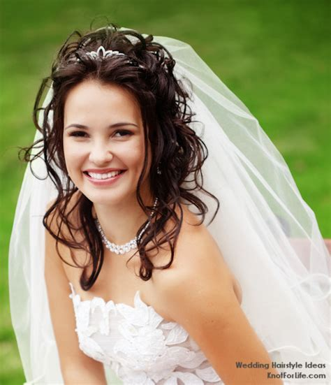 wedding hairstyles curly hair veil wavy wedding hairstyle with a veil and tiara knot for life