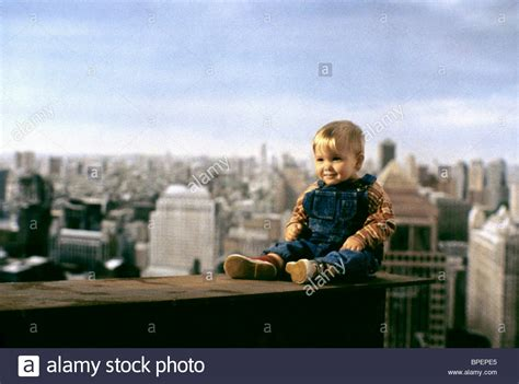 babys day out baby boy sit on steel girder baby s day out 1994 stock