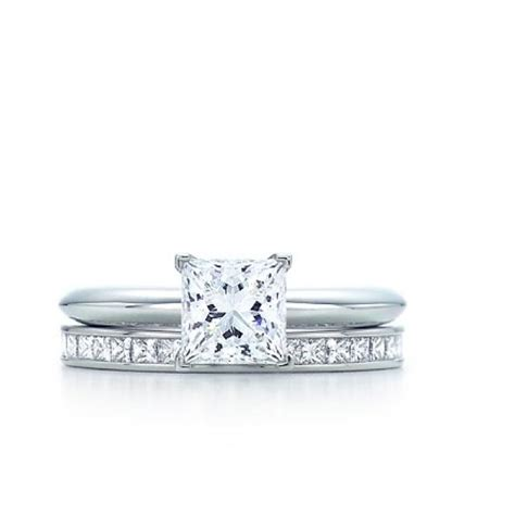 princess cut solitaire with channel setting wedding band