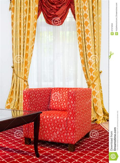 carpet and drapes red chair in the room with vintage red carpet and classic