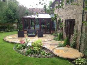 circular indian stone patio design incorporating water