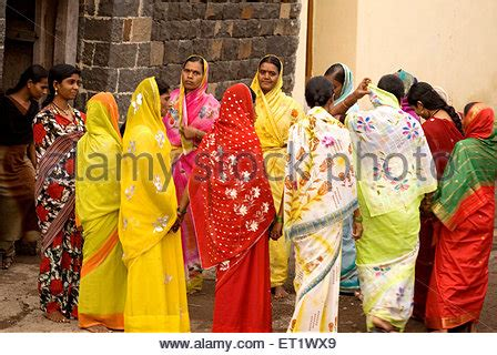 women dance in a traditional dance circle in honor of the