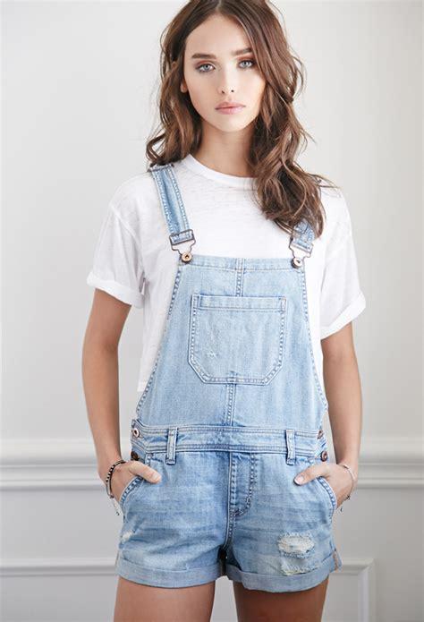 light blue denim overalls forever 21 distressed denim overall shorts in blue lyst
