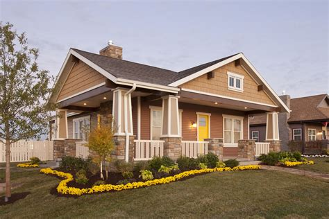 Adorable home exterior design with two facade and gable roof style featuring porch and deck with