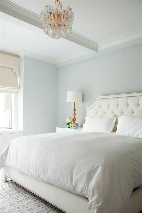 blue and white bedroom walls white tufted headboard with nailhead trim transitional