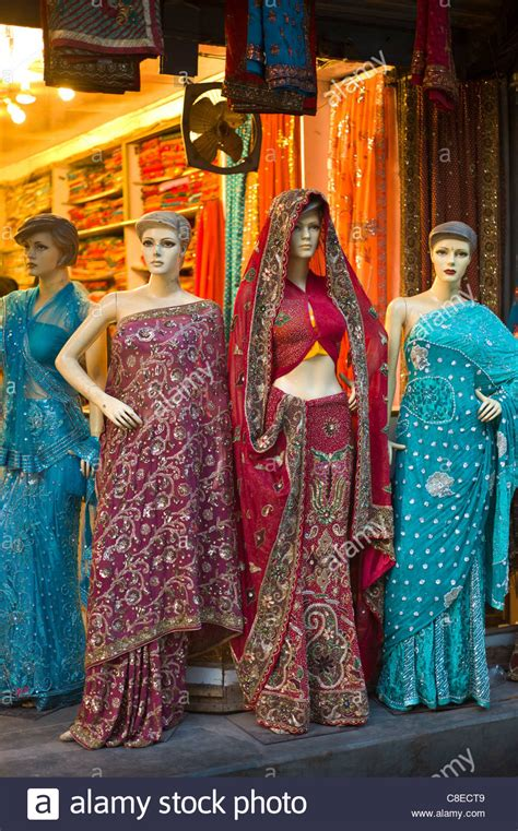 Wardrobe Shopping In India sari clothes shop in city of varanasi benares northern india stock photo royalty free image