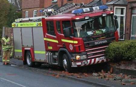 fire engine crashes  garden walls