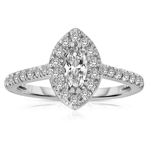 half carat marquise cut halo engagement ring in