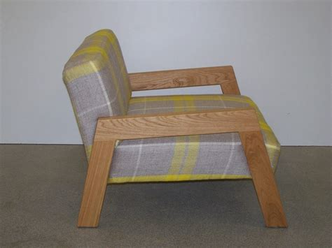 yellow and grey check chair low back lounge chair featuring solid oak legs armrests