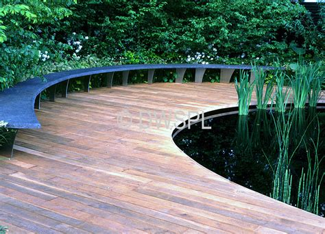 timber decking surrounding large fish pond for the pond erosa pond decking and