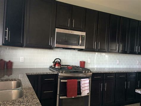 dark kitchen cabinets with backsplash white glass subway tile backsplash with dark cabinets