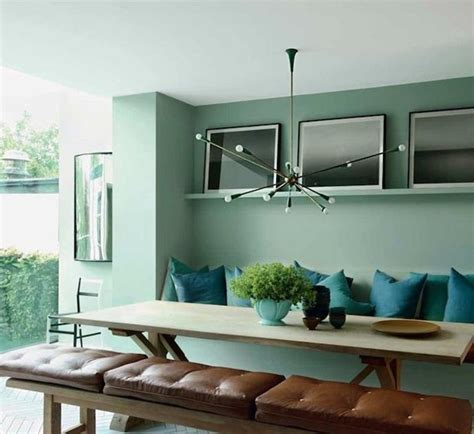 aqua dining room with modern chandelier the interior collective