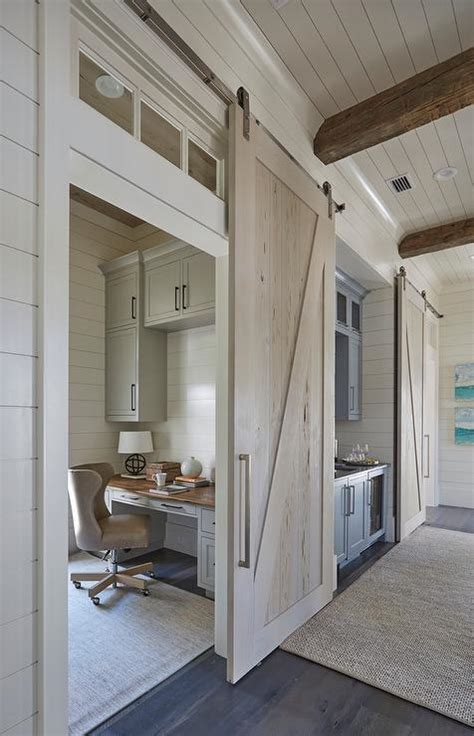 beach home bedroom with pecky cypress barn door on rails long hallway boasts a pecky cypress barn door on rails