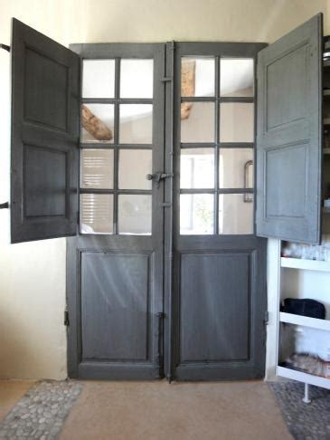 Doors Between Kitchen And Bathroom by Door With Folding Shutters Decorative Door Between