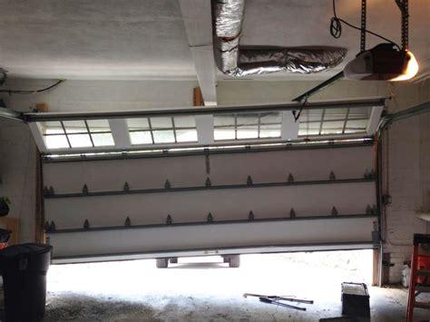 Garage Door Repair New Rochelle by Out Of Tracks Garage Door New Rochelle Out Of Tracks