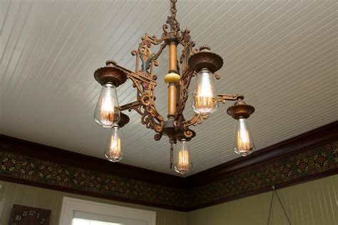 antique light fixture in dining room hooked on houses