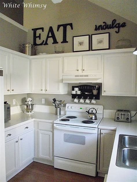 small cabinets above kitchen cabinets black accents white cabinets really liking these small
