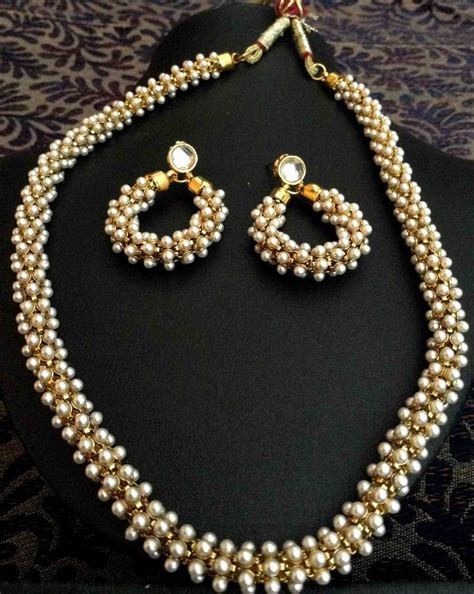 Supplier Real Indian Set By Hana buy beautiful chandni pearls woven in golden metal indian