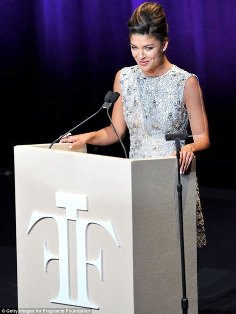 Dress Mic Mol adds a daring twist to demure dress with sheer panel at fragrance awards