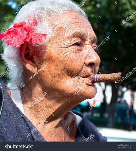 images of 64yr old wrinkly women old wrinkled woman with red flower smoking cigar santiago