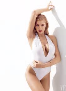 The carl s jr commercial girl models a white swimsuit with a halter