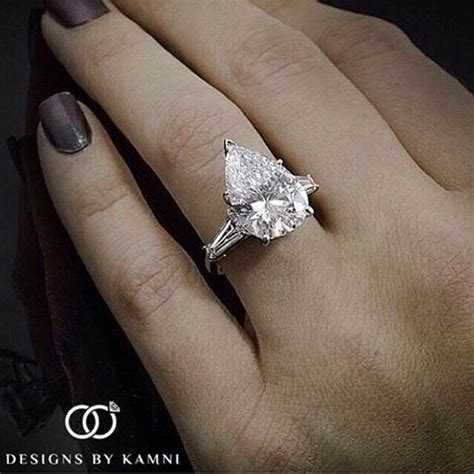 design by kamni instagram beautiful pear shape solitaire setting with tapered
