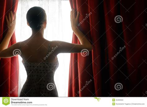 curtains woman red curtains stock photo image 45463322
