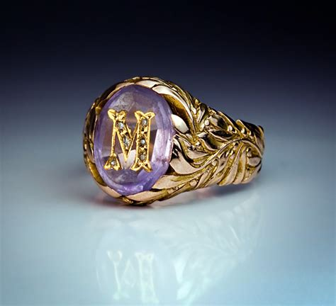 gold and amethyst rings monogram m ring