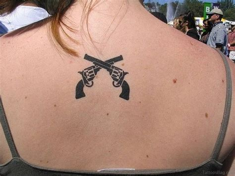 crossed revolvers tattoo 64 ultra modern gun tattoos for back