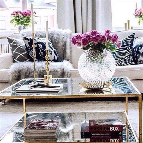 glass coffee table decor 5 key pieces for a chic coffee table flower glasses and fur