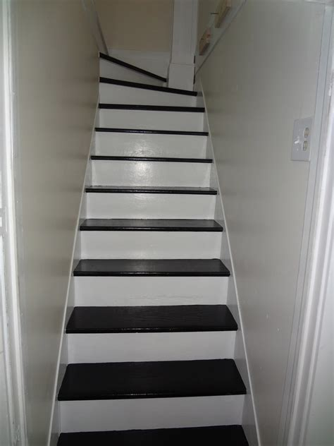 black staircase heir and space black and white stairs