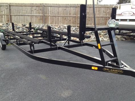 tritoon boat trailer loading guides mid america pontoon trailers