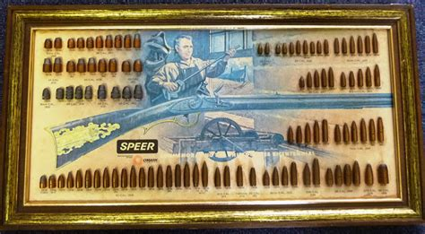 vintage store display ammo bullet boards ammo and gun