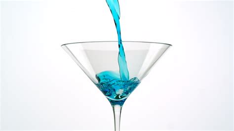 blue martini clip pouring blue martini into martini glass shooting with high