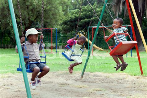 children on swing three children on the swings stock photos freeimages com