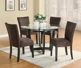 modern round dining room set with brown chairs casual